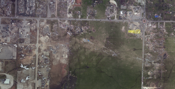 The destroyed Fastrip is highlighted in yellow. A swath of partial vegetation scouring and wind rowing to the south of the store indicates the storm's strongest winds may have just missed the area.