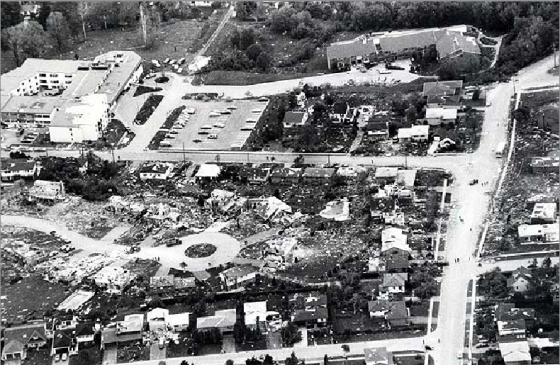 Aerial view of a narrow path of destruction on Murray Street in Barrie, Ontario.
