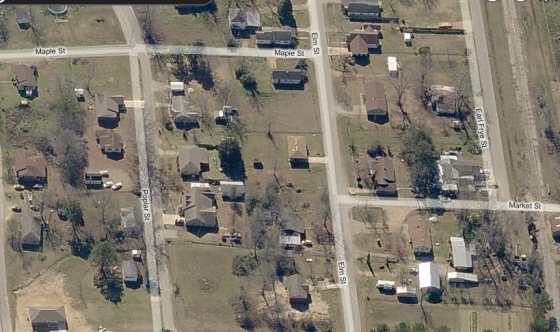 South facing view of homes along Elm Street and Poplar Street before the tornado. The section of Market Street that was later torn from the ground is visible at extreme lower right. Most of the residences in the area were old one and two-story homes, some of which were well anchored to their foundations. (Bing Maps)