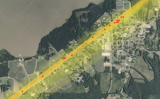 Map of the tornado's path through town in relation to the location of fatalities, marked by red dots.
