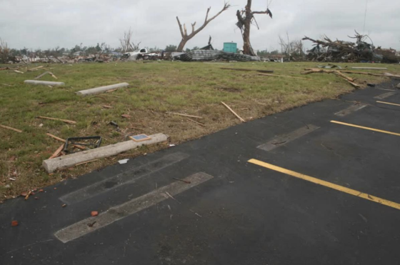 After leveling the Elk Lodge and causing five fatalities, the tornado continued to rapidly intensify as it devastated medical buildings just west of St. Johns Hospital. Large concrete parking stops weighing approximately 300lbs were ripped from their steel-anchors and hurled more than 50 yards.