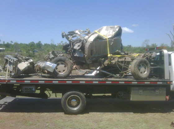 Image of the remains of Colt Robinson's truck as it was being towed away by the insurance company. (Image courtesy of Colt Robinson)