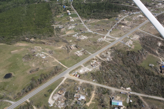 Second view of the tornado damage in southwestern Phil Campbell. The damaged storm cellar is visible at center left.