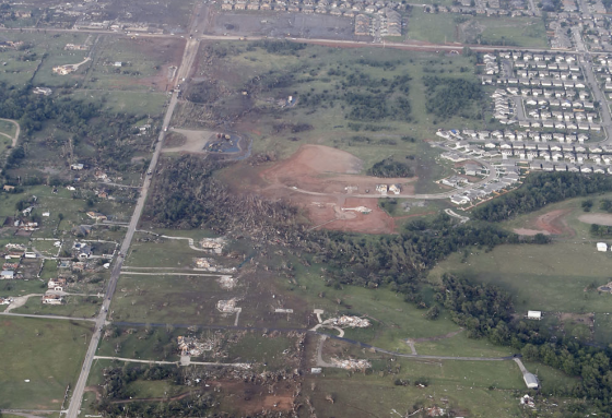 Ground scouring and empty foundations near Country Edge Drive, a half mile west of Moore. (Image by Steve Gooch)