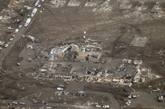 Probable EF5 damage to Plaza Towers Elementary School and homes to the south, which were swept from their foundations. Wind rowing and ground scouring were evident throughout the damage path in Moore.