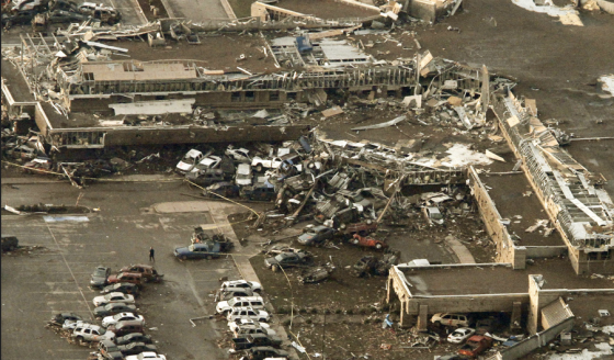 The Moore Medical Center was impacted directly by the probable EF5 tornado. Dozens of cars in the adjoining parking lot were piled against the structure's western wing. (Image by Steve Gooch)