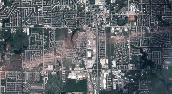 Satellite view of the tornado's devastating path through Moore. The tornado's most intense damage may have occurred just southwest of Briarwood Elementary School (far left).
