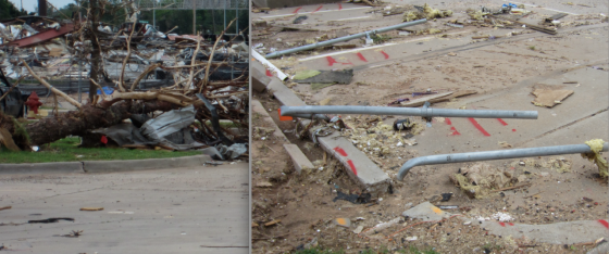 Just west of the freeway, a large bowling alley was leveled to the ground. The steel cross-beams overlying the structure were broken and denuded. In the building's parking lot, parking signs were bent to the ground facing south. Some of the signs were bent in opposing directions at the base or snapped off entirely.