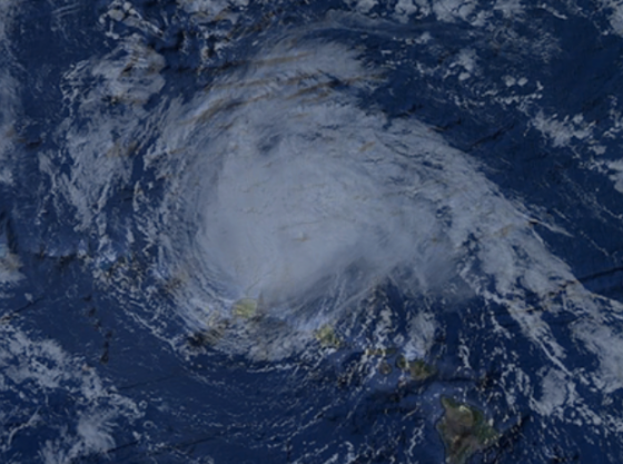 Hurricane Hiki was the first operationally verified tropical cyclone to affect the Hawaii. The unusually small hurricane brought tropical storm force winds to the northern coasts of several islands. Above is a creative representation of the storm as it passes north of Kauai.