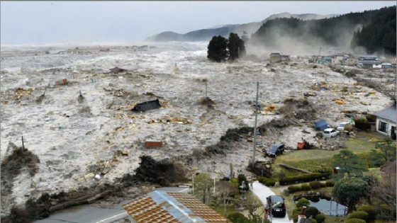 Few images exist of the tsunami in Rikuzentakata due to the low survival rate in the inundation zone. One image captured the first wave sweeping across a residential area a mile from the bayfront.