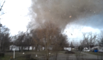 Frame of the tornado as it passes over the school complex. (Video by Rhett Adams)
