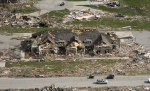 View of damage to First State Bank and the home captured in the surveillance footage.