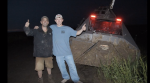 The crew poses next to the TIV2, which was caked in mud by the tornado.
